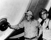 Homestake Mine: Ray Davis and John Bahcall pose by the tank