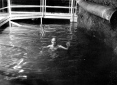 Ray Davis swim in the 300,000-gallon tank of water a mile underground in the Homestake mine