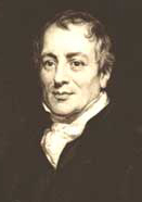 David Ricardo British economist   Born , April 18/19, 1772, London, England died September 11, 1823, Gatcombe Park, Gloucestershire  English economist who gave systematized, classical form to the rising science of economics in the 19th century. His laissez-faire doctrines were typified in his Iron Law of Wages, which stated that all attempts to improve the real income of workers were futile and that wages perforce remained near the subsistence level.  Ricardo was the third son born to a family of Sephardic Jews who had emigrated from the Netherlands to England. At the age of 14 he entered into business with his father, who had made a fortune on the London Stock Exchange. By the time he was 21, however, he had broken with his father over religion, become a Unitarian, and married a Quaker. He continued as a member of the stock exchange, where his talents and character won him the support of an eminent banking house. He did so well that in a few years he acquired a fortune, which allowed him to pursue interests in literature and science, particularly in the fields of mathematics, chemistry, and geology.  Ricardo's interest in economic questions arose in 1799 when he read Adam Smith's Wealth of Nations. For 10 years he studied economics, somewhat offhandedly at first and then with greater concentration. His first published work was The High Price of Bullion, a Proof of the Depreciation of Bank Notes (1810), an outgrowth of letters Ricardo had published in the Morning Chronicle the year before. His book refueled the controversy then surrounding the Bank of England: freed from the necessity of cash payment (strains from the wars with France prompted the government to bar the Bank of England from paying its notes in gold), both the Bank of England and the rural banks had increased their note issues and the volume of their lending. The directors of the Bank of England maintained that the subsequent increase in prices and the depreciation of the pound had no relation to the 