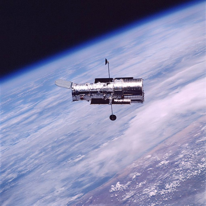 Hubble floating above Earth during servicing mission 3B, March 2002.