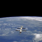 14. ISS: nearest the camera is the Progress supply craft, which joined ISS in August 2000