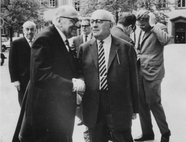 Max Horkheimer (front left), Theodor Adorno (front right), and Jürgen Habermas in the background, right, in 1965 at Heidelberg.