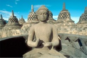 Buddha statue on the upper terrace of Borobudur Stupa, Java, Indonesia