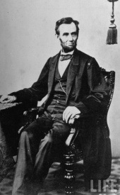 President Abraham Lincoln sitting in a chair (1864)