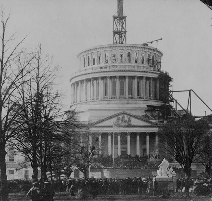 Abraham Lincoln Was Sworn In Under a Half-Finished Capitol Dome   As Abraham Lincoln took the oath of office on March 4, 1861, the United States was in crisis. Southern states had been seceding, and it seemed that Civil War was unavoidable. There was fear that Lincoln would be assassinated before he could take the oath, and General Winfield Scott ordered Army sharpshooters placed on the roofs of buildings in Washington.  The US Capitol was undergoing expansion, and the new cast iron dome was still being assembled atop the building in early 1861. Lincoln's inauguration was thus held before the half-finished dome.  Source: Robert McNamara, About.com