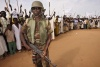 Darfur militia man and locals