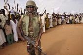 Darfur militia man and locals