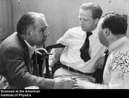 Niels Bohr, Werner Heisenberg, and Wolfgang Pauli talking in the Niels Bohr Institute lunchroom, possibly 1934 or 1936
