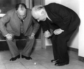 Wolfgang Pauli and Niels Bohr demonstrating 'tippy top' toy