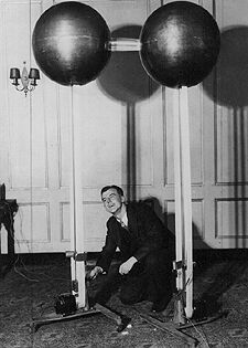 Van de Graaff fixing his first generator  In 1929 Van de Graaff returned to the United States to join the Palmer Physics Laboratory at Princeton University as a National Research Fellow. In the fall of that year he constructed the first working model of his electrostatic accelerator which developed 80,000 volts. Improvements were made to the basic design and in November, 1931 at the inaugural dinner of the American Institute of Physics, a demonstration model was exhibited that produced over 1,000,000 volts. The invention was reported at a meeting of the American Physical Society in 1931.   Source: http://chem.ch.huji.ac.il/history/graaff_generator2.jpg