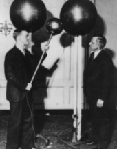 Van de Graaff demonstrating his first generator to Karl Compton